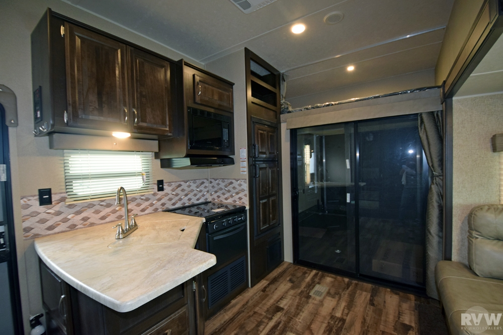 Click here to see the New 2017 Puma 356QLB Toy Hauler Fifth Wheel by Palomino at RVWholesalers.com