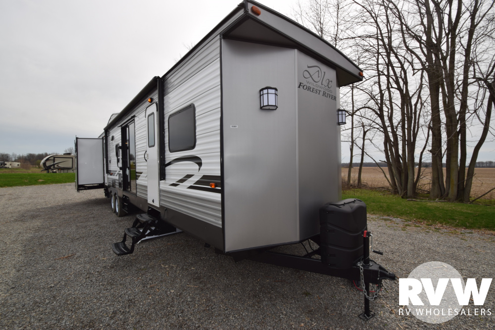 Click here to see the New 2019 Wildwood DLX 42QBQ Park Trailer by Forest River at RVWholesalers.com
