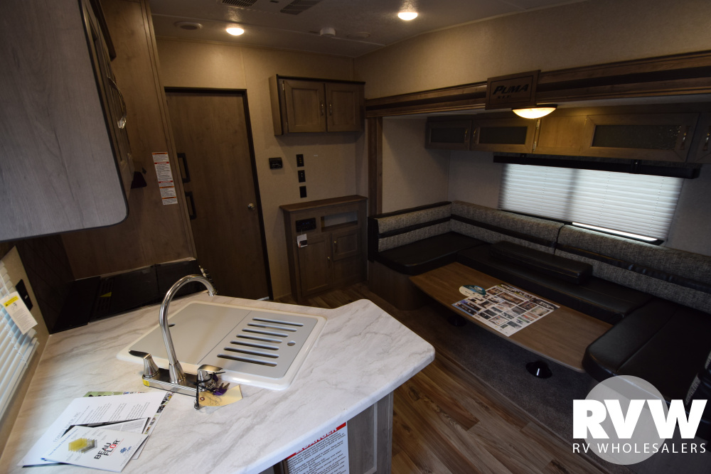 Click here to see the New 2020 Puma XLE 29FQC Toy Hauler Travel Trailer by Palomino at RVNation.us