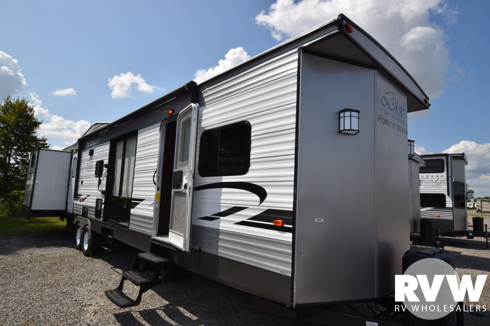 Click here to see the New 2020 Wildwood DLX 42QBQ Park Trailer by Forest River at RVWholesalers.com