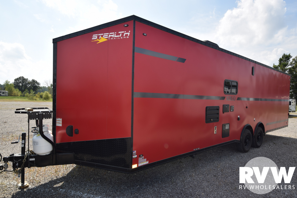Click here to see the New 2020 Nomad 30DB Toy Hauler Travel Trailer by Stealth at RVWholesalers.com
