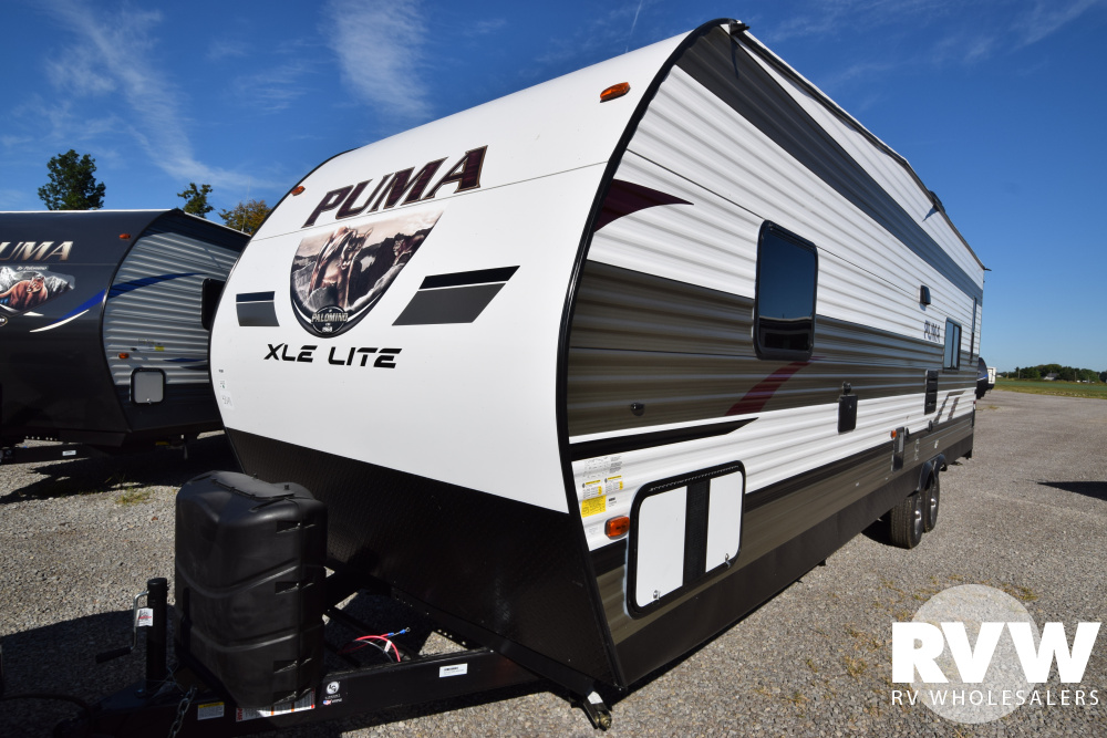 Click here to see the New 2020 Puma XLE 27QBC Toy Hauler Travel Trailer by Palomino at RVWholesalers.com