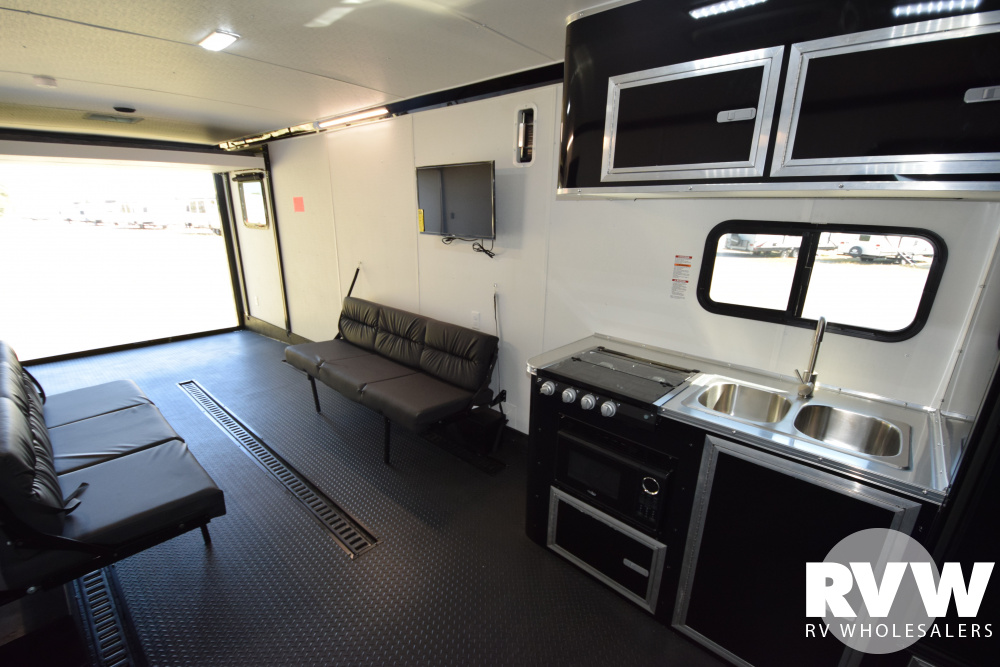 Click here to see the New 2020 Nomad 30FB Toy Hauler Travel Trailer by Stealth at RVNation.us