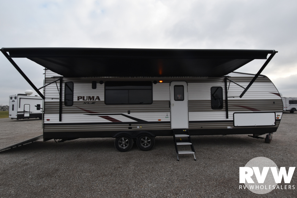 Click here to see the New 2020 Puma XLE 27TSB Toy Hauler Travel Trailer by Palomino at RVWholesalers.com