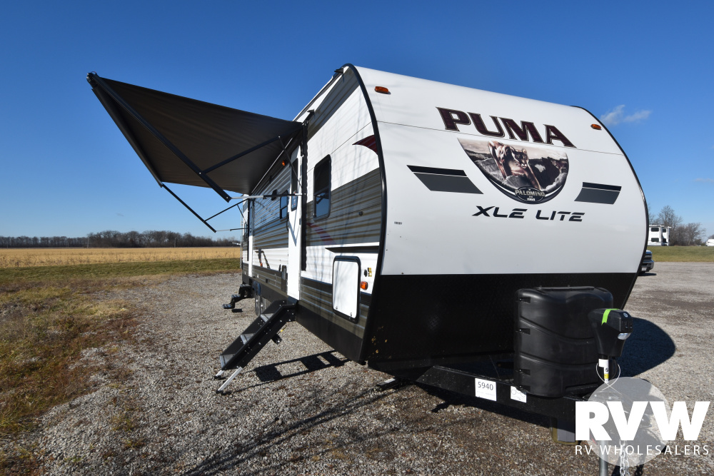 Click here to see the New 2020 Puma XLE 29TSS Toy Hauler Travel Trailer by Palomino at RVWholesalers.com