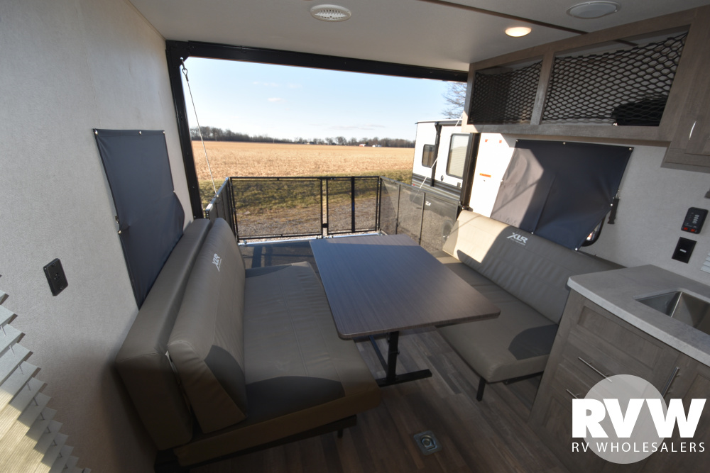 Click here to see the New 2020 XLR Micro Boost 25LRLE Toy Hauler Travel Trailer by Forest River at RVWholesalers.com
