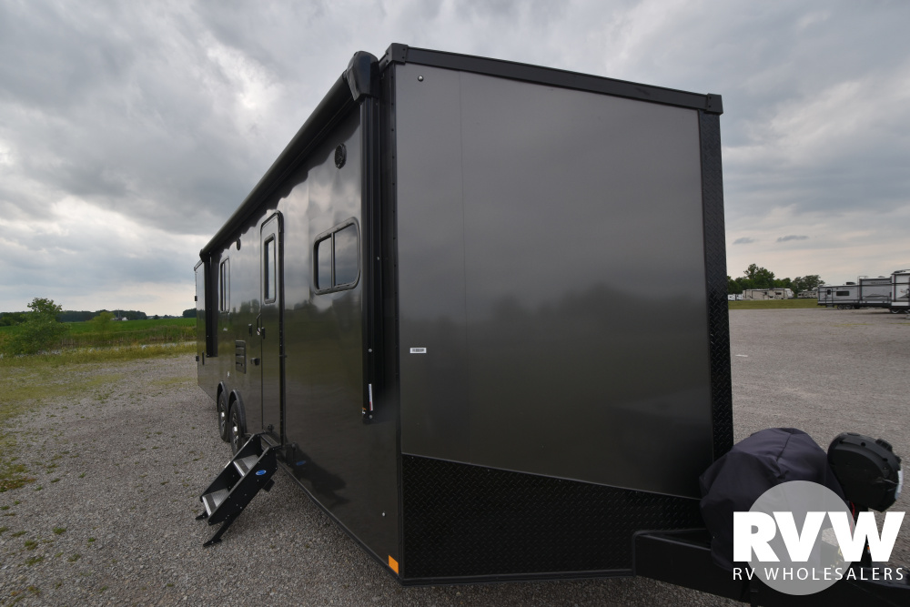 Click here to see the New 2020 Nomad 28NQB Toy Hauler Travel Trailer by Stealth at RVWholesalers.com