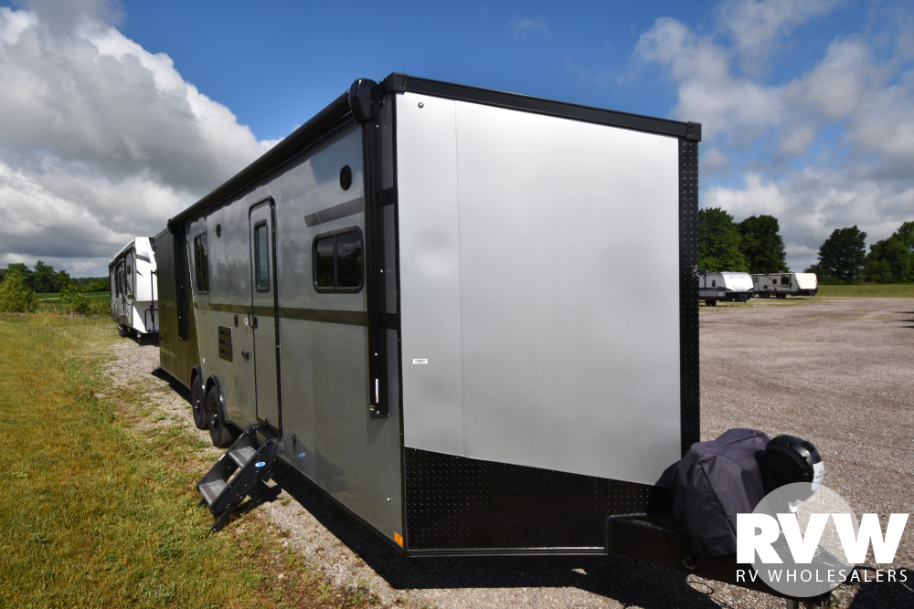 Click here to see the New 2020 Nomad 30NQB Toy Hauler Travel Trailer by Stealth at RVWholesalers.com