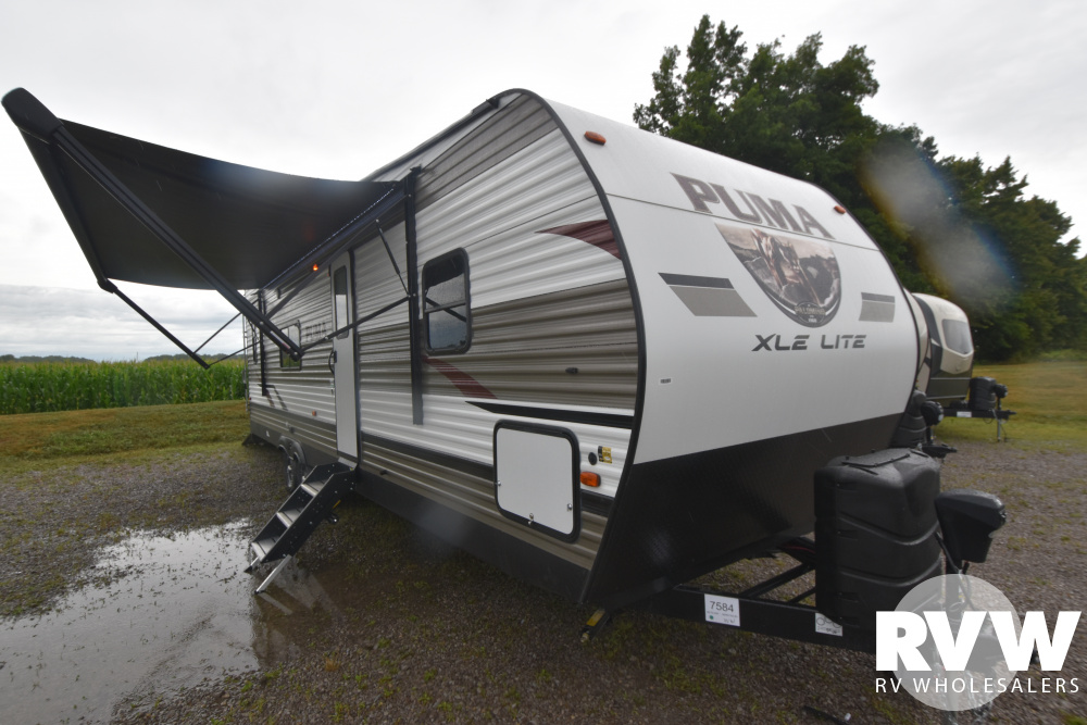 Click here to see the New 2021 Puma XLE 27QBC Toy Hauler Travel Trailer by Palomino at RVWholesalers.com