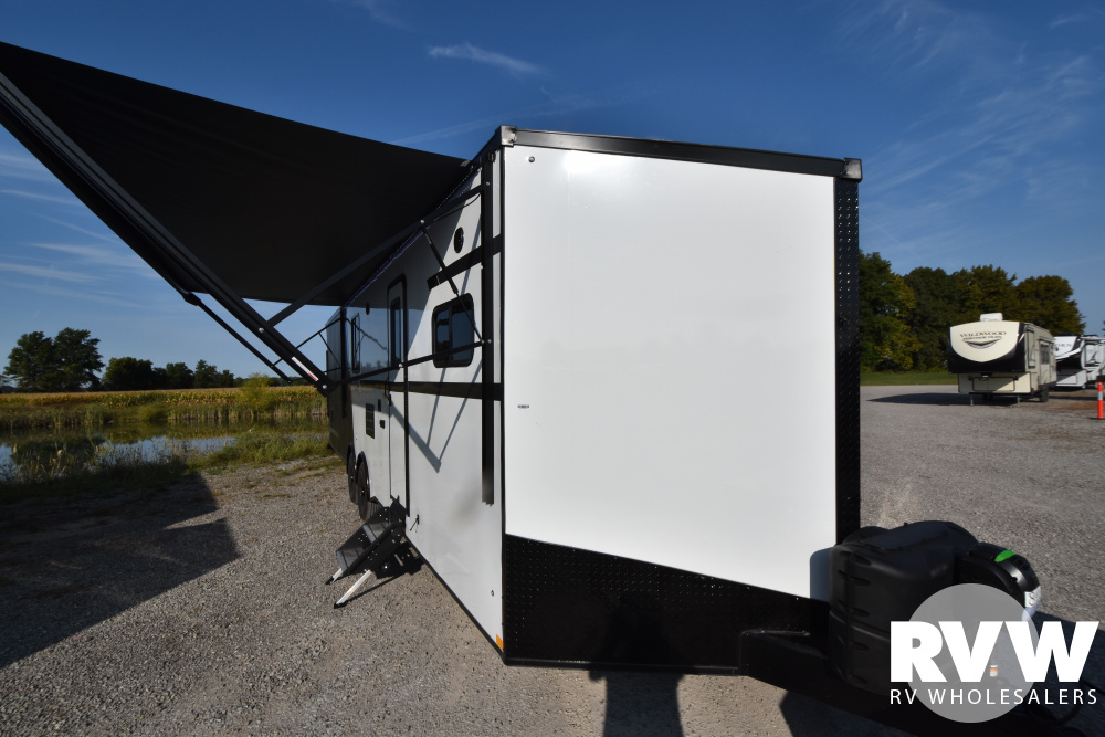 Click here to see the New 2021 Nomad 30NQB Toy Hauler Travel Trailer by Stealth at RVWholesalers.com