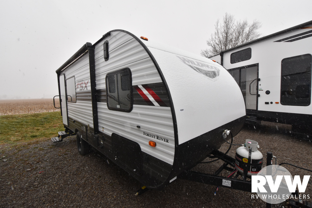 Click here to see the New 2021 Wildwood FSX 181RT Toy Hauler Travel Trailer by Forest River at RVWholesalers.com