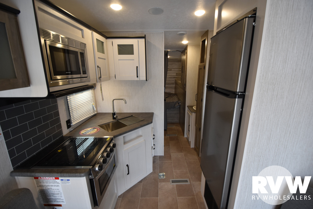 Click here to see the New 2021 Puma XLE 25TFC Toy Hauler Travel Trailer by Palomino at RVWholesalers.com