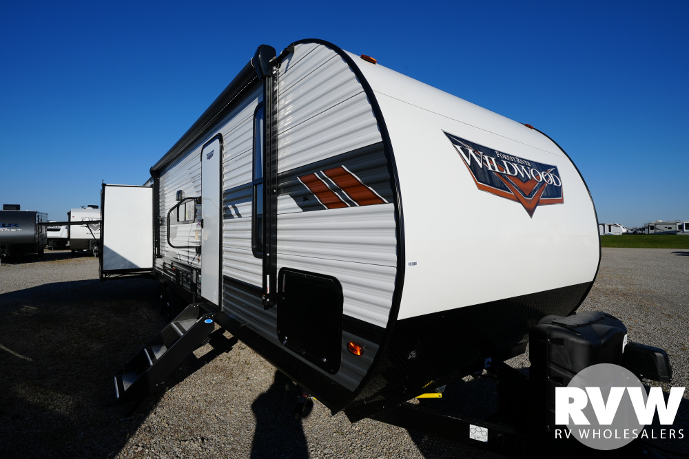 Click here to see the New 2022 Wildwood 31KQBTS Travel Trailer by Forest River at RVWholesalers.com